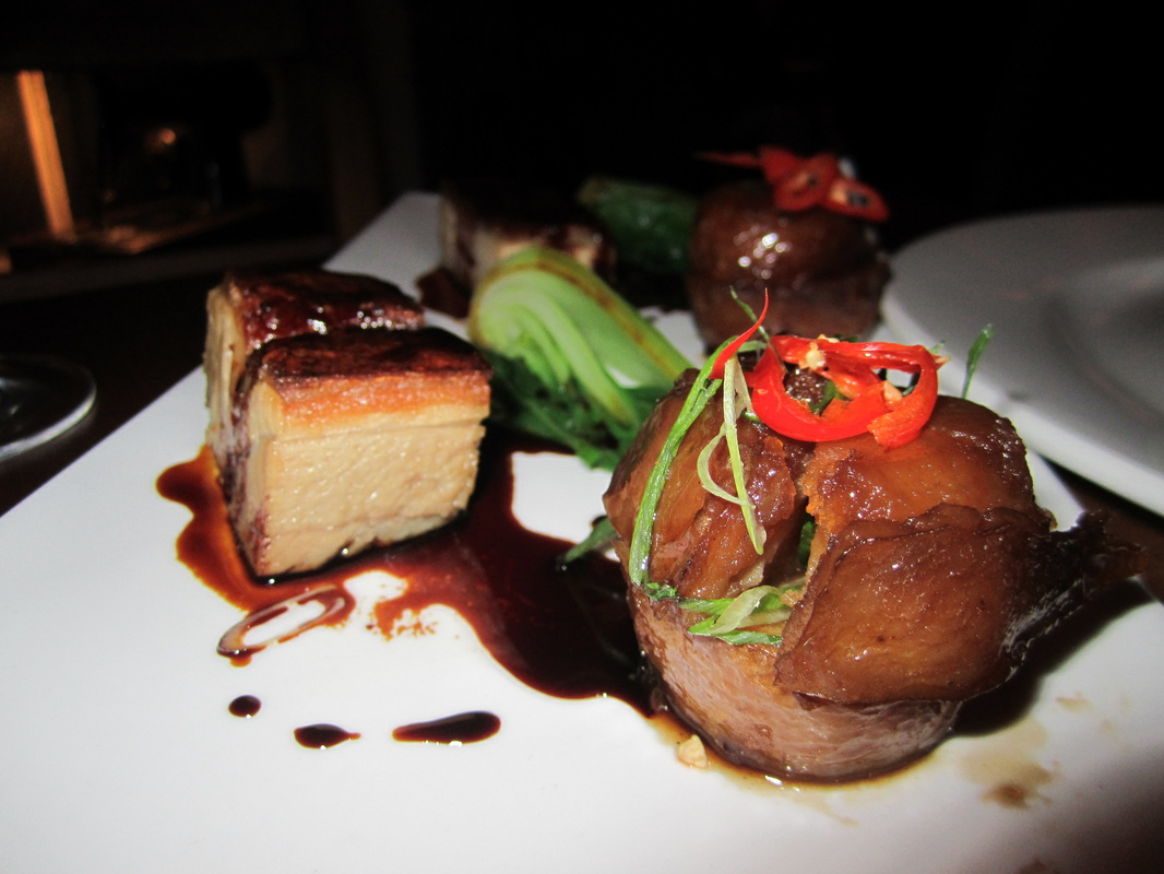 Our main courses were the twelve hour braised Berkshire pork belly ...